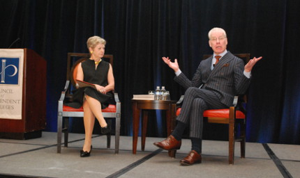 Georgia Nugent and Tim Gunn seated on chairs on stage