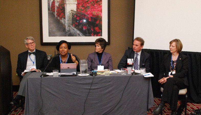 Five panelists present from the head table