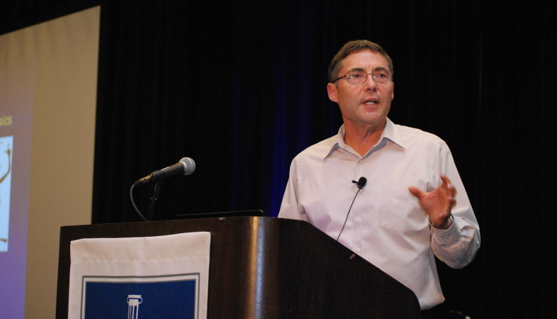 Carl E. Wieman presents from the podium