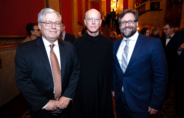Richard Ekman stands with Father Columba Stewart and Jon Parrish Peede