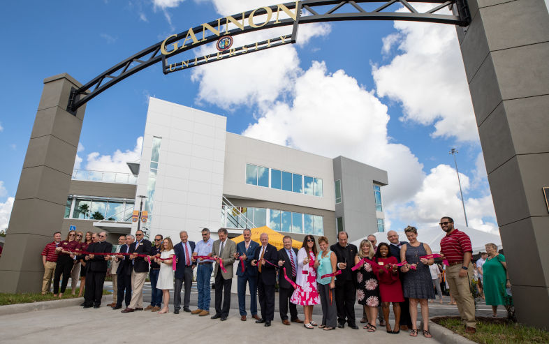 Ribbon-cutting ceremony in front of new building