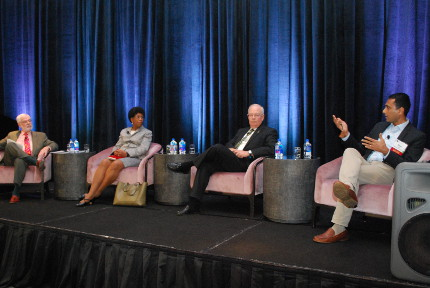 Sanford J. Ungar, Eileen B. Wilson-Oyelaran, Ken Starr, and Eboo Patel present from chairs on stage