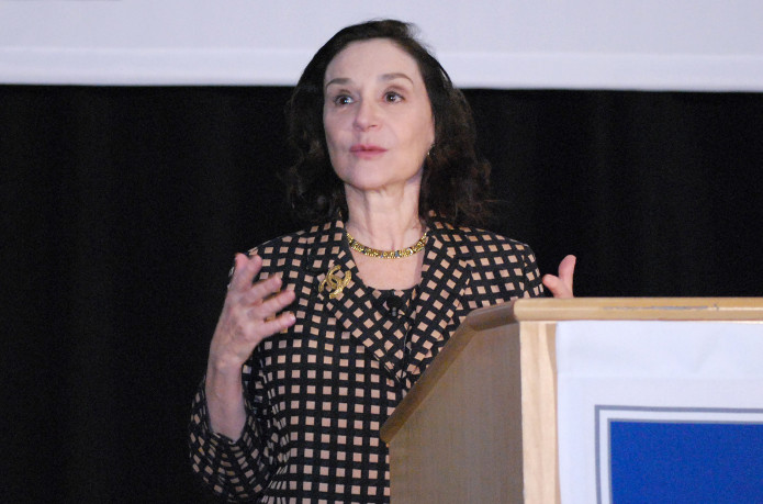 Sherry Turkle presents from the podium gesturing with her hands