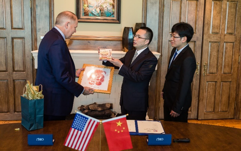 Representatives from Oral Roberts University and Chongqing City Vocational College exchange gifts