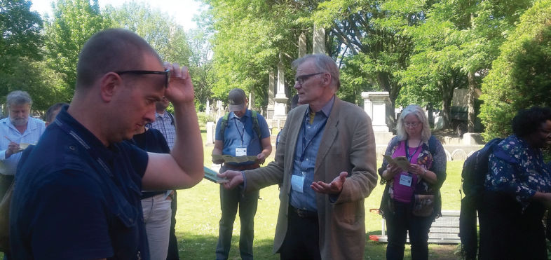 David W. Blight stands with participants in Grove Street Cemetary