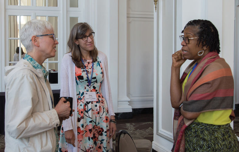 Eileen Wilson-Oyelaran speaks with two participants