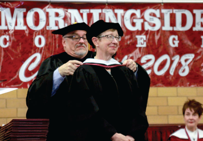 Bill Deeds places a doctoral hood on Kathy Whatley