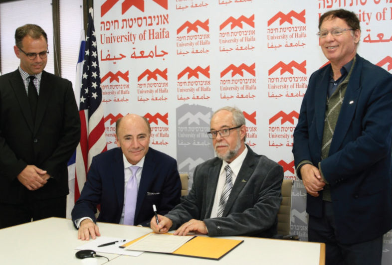 Four university officials sign collaboration agreement