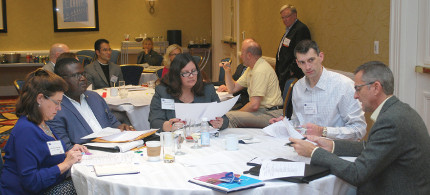 participants share ideas at a roundtable discussion