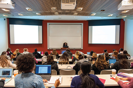 a professor addresses nursing students in a new classroom