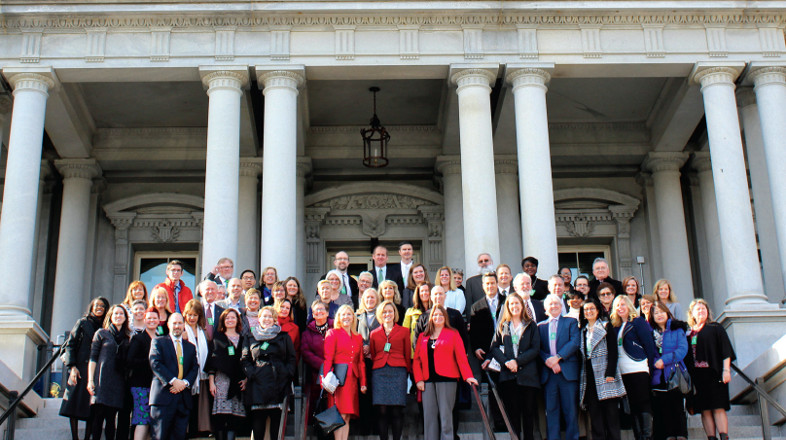 the summit participants gathered on the steps of the Eisenhower Executive Office Building