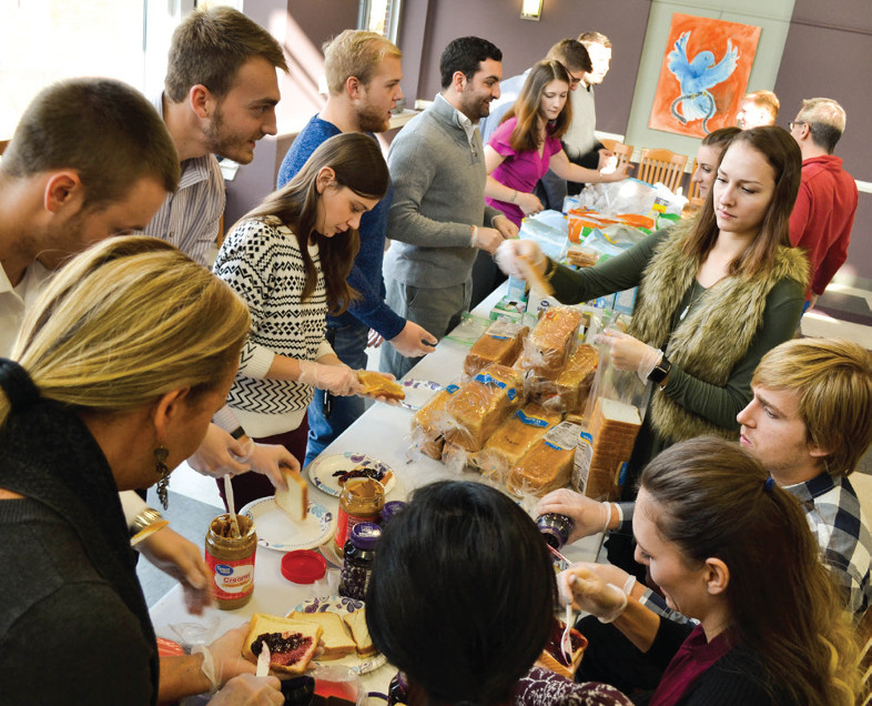 room full of students prepare lunches