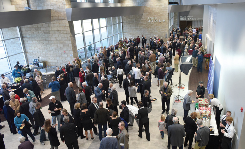large group of people standing during reception in Shari Flaming Center for the Arts