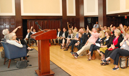Participants raise their hands to ask questions to Eleanor Clift