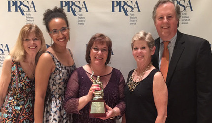 Judy Phair, Lilia LaGesse, Laura Wilcox, Georgia Nugent, and Jeff Davis pose with the Silver Anvil award.