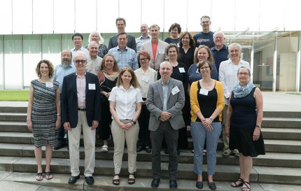 Group photo of seminar participants standing on steps