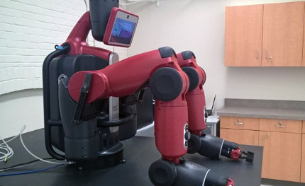 robot with articulated arms sitting on a laboratory table